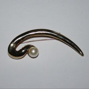 Long vintage gold and pearl brooch